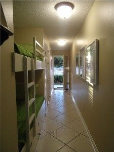 Our 'Emerald Blue Condo' hallway bunk area and on the ground floor leading straight out to the pool.  VRBO #432688 Destin, FL area