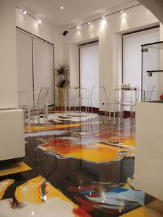 Artistic resin floors 2 Laying and production of artistic epoxy resin floors for stores, bars and restaurants. In the image above the laying of a bar, produced by Colledani - epoxy resin floors.