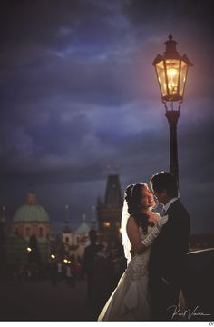 romantic night time pre-wedding photos from the Charles Bridge in Prague by Kurt Vinion.
