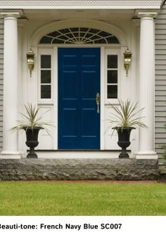 French Navy front door. I'm digging it! - love the white with the pop of french navy.