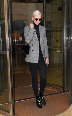 Karlie Kloss SplashNews Layer a black turtleneck underneath a gray checked blazer for a timelessly polished look.