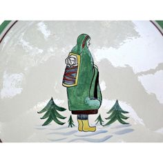 A vintage, Henriot Quimper France hand painted plate showing an Eskimo, Inuit, lady with papoose on her back. Plate is nine and a half inches round