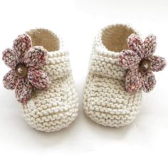 These special little shoes/booties have been knitted with lovely Sirdar cotton blend yarn. They are adorable in cream with pastel mix knitted flowers finished with tiny buttons. The buttoned strap is for decoration only. They are light and comforta Baby Booties Knitting Pattern, Crochet Baby Shoes, Crochet Baby Booties, Baby Knitting Patterns, Baby Patterns, Hand Knitting, Crochet Patterns, Crochet Hats, Steve Madden Schuhe