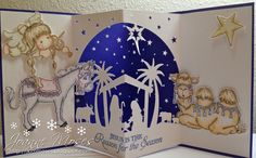 Christmas Card with Die Cuts made with Silhouette Cameo and Magnolia Nativity Collection Stamps (Tilda with Violin, Ella the Donkey and Jacob the Camel)