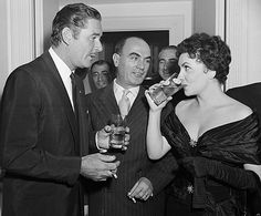Errol Flynn, Vittorio Vassarotti and Gina Lollobrigida