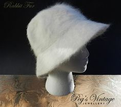 Angora - Rabbit Fur bucket hat is one size fits all. Approx 20 circumference inside. This soft fuzzy fabric is a creamy - white color