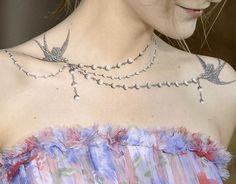 "http://www.revelist.com/arts/necklace-tattoos/5537/""Necklace tattoos"" are part neck tattoo, part chest tattoo./1/#/1"