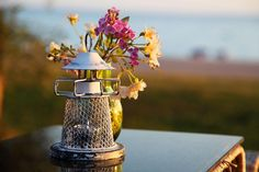 arrangement,candle,decoration,dining,flower,holder,nature,romance,romantic,stand,table,restaurant,beach,sunset,evening