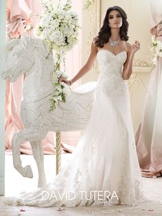 David Tutera for Mon Cheri style, 215267, Nala, is a romantic strapless wedding dress designed for the Fall 2015 Bridal Gown Collection. Click for details.