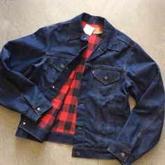 Super dark Levi's 4 pocket Jean jacket with cotton flannel lining, size 42L, $85+$16 domestic shipping. Call 415-796-2398 to purchase or PayPal afterlifeboutique@gmail.com and reference item in post.
