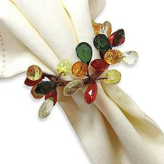 Autumn Sparkle Napkin Ring. Plastic beads in fall colors wired in a circle. $2.99 ea at bedbathandbeyond.com