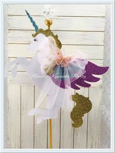 "This Unicorn Centerpiece pole can be made up to 40"" tall - Please write the height of pole you would like in the Height portion of your order. Everyone wants to celebrate their Birthday Party or Baby Shower in a unique way that expresses their personal style, from the candy bar to the table decor. Perfect also for a Circus Theme or Carnival decorations. Naming parties also, this would be that special touch. This Unicorn Centerpiece makes an adorable center of attention to your table. Place…"