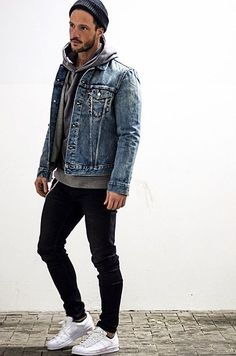 The versatility of a blue denim jacket and black skinny jeans makes them investment-worthy pieces. This outfit is complemented perfectly with white low top sneakers. Shop this look on Lookastic: https://lookastic.com/men/looks/denim-jacket-hoodie-skinny-jeans/18008 — Black Beanie — Grey Hoodie — Blue Denim Jacket — Black Skinny Jeans — White Low Top Sneakers
