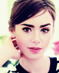 Lily Collins-eyebrow perfection and love her pink make up!