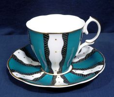 RARE SUSIE Cooper China Art Deco Blue-Green Black White Bands Cup and + Saucer - $99.99. This is for a Rare Susie Cooper China Cup + Saucer with an Art Deco style design of Blue-Green and Black + White Bands with Gold accents. Has Gold Trim. Cup is approximately 2-7/8 in. tall and 3-1/4 in. across at top not counting handle; saucer is 5-5/8 in. across. Great condition. There are no crazing, chips or cracks. Buyer to pay $9.00 for shipping and handling for U.S. address. We ship ...