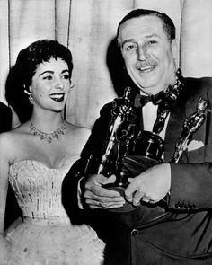 Elizabeth Taylor and Walt Disney at The 26th Academy Awards where Disney was awarded three Oscars