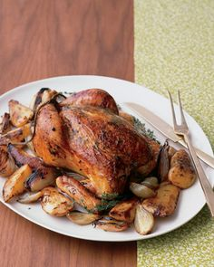 Roasted Chicken with pear, shallots, and thyme. Adding pears to a traditional roast chicken gives it moisture and a bit of sweetness.