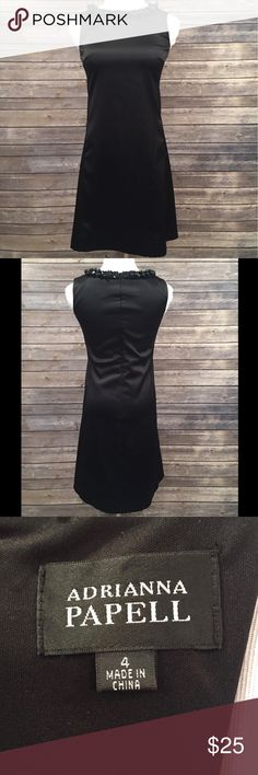 Adrianna Papell Sleeveless Black Beaded Dress EUC. Tiny marks are shown in photos. Length is 34.5 inches. Shell is 97% Polyester and 3% Spandex while the lining is 100% Polyester. It looks like there were pockets but someone professionally sewed them shut.   Fast Shipping! Packaged with care 10% off bundles!   ⭐️20% of earnings are donated to the A21 campaign that works toward ending human trafficking  ❣️27 MILLION slaves worldwide- Most in history! 💔1-2% rescued ❣️The average age of a…