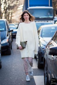 Labériane Ponton of The Blab wearing Designers Remix jumper, Ganni dress, Little Liffner bag and Adidas Stan Smith trainers before Rochas fashion show. Shop this look (or similar) here: Dress: Ganni California Lace Dress Jumper: MARNI Oversized organza-trimmed knitted sweater Trainers: ADIDAS