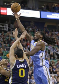Nuggets dominate 4th, beat winless Jazz 100-81 | Denver Nuggets' Kenneth Faried, right, lays the ball up as Utah Jazz's Richard Jefferson, left, and teammate Enes Kanter (0), of Turkey, defend in the first quarter during an NBA basketball game Monday, Nov. 11, 2013, in Salt Lake City. (AP Photo/Rick Bowmer)