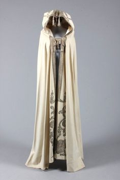 Middle East, embroidered felted wool cape, late 19th century, the elaborate hood couched and embroidered in silver threads, edged in braid and adorned with sequined tassels, similarly embroidered front panels