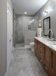 Contemporary 3/4 Bathroom with Winstead Cabinet Door Style, Complex marble counters, frameless showerdoor, Double sink, Flush