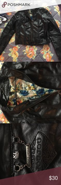 Black FAUX Leather Jacket Black leather jacket, joujou brand, size xl, interior has a cute flower pattern, zips up the middle, can be buttoned on the bottom as well shown in pic, worn a few times but great condition Jou Jou Jackets & Coats