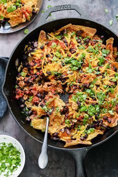 Everyone will love these unconventional vegan skillet enchiladas made in one skillet with soy curls, black beans, sauteed veggies, cashew queso, and crunchy tortilla chips. Garnish with your favorite Mexican toppings like cilantro, vegan shredded cheese, and avocado. A great recipe for 5 de Mayo or Tacos Tuesday #vegan #mexican Skillet Enchiladas, Vegan Enchiladas, Homemade Enchiladas, Skillet Nachos, Vegan Cheddar Cheese, Vegan Queso, Vegan Mexican Recipes, Delicious Vegan Recipes, Ethnic Recipes