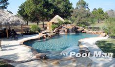 custom pool with rock waterfall, Spring swimming pools  www.poolmaninc.com