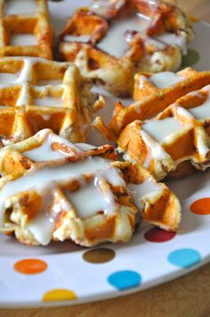 Cinnamon rolls in a waffle iron :)  Spray your waffle iron with cooking spray and arrange your rolls close to the center.   You DO NOT want them squishing out of the edge. Just a couple minutes later...and we had cinnamon roll waffles!   Drizzle with icing... and Wha-La