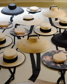 Falling in fashion love in Barcelona. These wide brimmed straw hats with ribbons are so feminine and stylish.