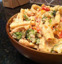 Creamy Spicy Chicken Pasta and Veggies - cooked chicken and broccoli, asparagus, red or yellow bell pepper, grape tomatoes and a spicy cream sauce served over penne pasta.