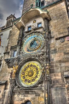 astronomical clock, Prague. Built in 1410, the apparatus is the world's oldest functioning astronomical clock. It adorns the facade of the Old Town Hall of Prague's Old Town Square. The clock's astronomical dial tracks the motion of the sun, moon and stars