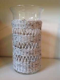 Knit Vase Tundra. Approximate size: diameter base: 12,7 cm; diameter top: 15,5 cm; height: 28 cm. Glass with removable hand-knitted cover - hand washable 74% acryl, 20% wool, 6% viscose mix. Suggested uses as - flower vase (fresh or dried) - votive candle holder (tea licht candle holder included) - wine cooler - home scent stick holder (no flame) - container for small objects or electronic appliances chargers. Price: 80 EUR excl. shipping  from The Netherlands. To place an order email…