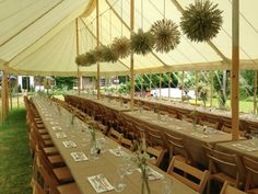 Canopy marquee, wooden poles and canvas with simple country inspired decorations