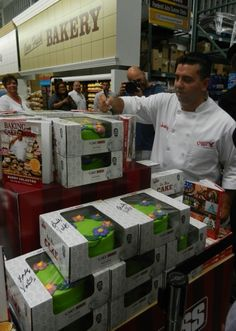 Buddy signing books and Cake Boss cakes at BJs!