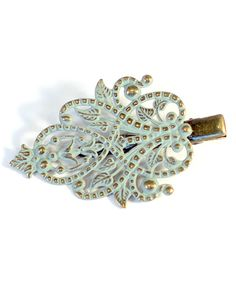 Gleeful Peacock Seaglass Muse Hair Clip | zulily  . $8.99 Compare at $15.00  .     Product Description:  Enjoy a vintage-inspired look with this accessory that tames tresses thanks to an alligator clip.      2'' L     Alligator clip     Brass / zinc alloy     Made in the USA