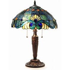 @Overstock - Intricate green stained glass leaves lace the rose and white scalloped shade. This lamp is placed on a metal base with bronze finish.http://www.overstock.com/Home-Garden/Tiffany-Style-Blue-Vintage-Table-Lamp/6982716/product.html?CID=214117 $105.99