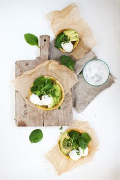 green mini pizzas with parmesan and pesto