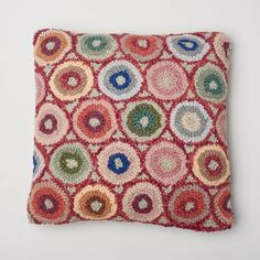 Intricate wool hooked pillow circles adorn this lovely pillow, front of pillow is wool, backing is cotton linen, zipper closure on back.