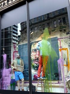 Harvey Nichols window display for menswear spring 2013 with artist Andrew Saldago in the Sloane St side of the store