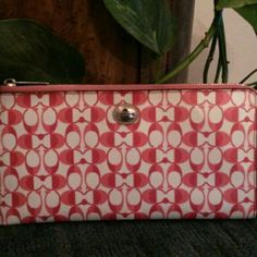 """Coach 50925 Peyton Dream C Travel Wallet Wristlet Pomegranate Signature Holdall Wristlet Coach Peyton Dream C Multifunction Wallet Dream C print coated canvas with leather trim White Pomegranate/Tan F50925 $248  Inside open pockets and six credit card pockets  Outside pocket  Zip-top closure, fabric lining  Strap with clip to form a wrist strap or attach to the inside of a bag  10"""" (L) x 5"""" (H)  This is a signature product Coach Bags Wallets"""