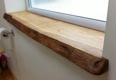 I like how this window sill is partly raw wood, like you can still tell that it came from a tree