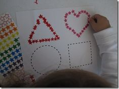 Tracing shapes with stickers....love it!