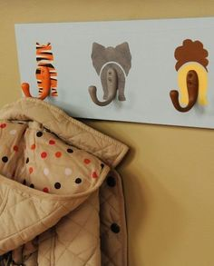DIY Animal Hooks Decorate a baby& nursery with this wildly adorable coat rack. To add texture, like fur, to your creatures, apply paint over the base coat using a stippling brush. Deco Jungle, Jungle Room, Safari Room, Safari Nursery, Themed Nursery, Jungle Safari, Animal Theme Nursery, Safari Bathroom, Noahs Ark Nursery