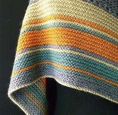 This garment is knitted using only four skeins of Cascade's gorgeous Pure Alpaca yarn. Using short rows to create sweeping blocks of colour, then striking stripes to finish this eye catching shawl.