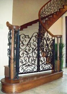 Iron Dog Gate-Evans Weaver - love this. We use iron baby gates to control where the dogs are but love the look of this on at the bottom of this staircase. Pet Gates For Stairs, Stair Gate, Staircase Gate, Stairway, Staircases, Wrought Iron Decor, Dog Rooms, Baby Gates, Iron Gates