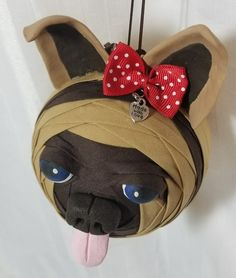 It's a doggy!  Folded fabric ornament ball. Made by Kathy Hatch pattern.