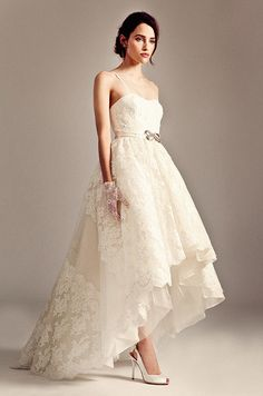We love the bow belt on this dreamy hi-low wedding dress from Temperley, Iris Collection.