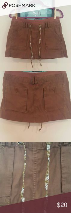 Free People Drawstring Skirt Size 8, fits sizes 8-10. Great used condition. Material is canvas likes, with soft waistband and floral drawstring. Color is mocha. Free People Skirts Mini